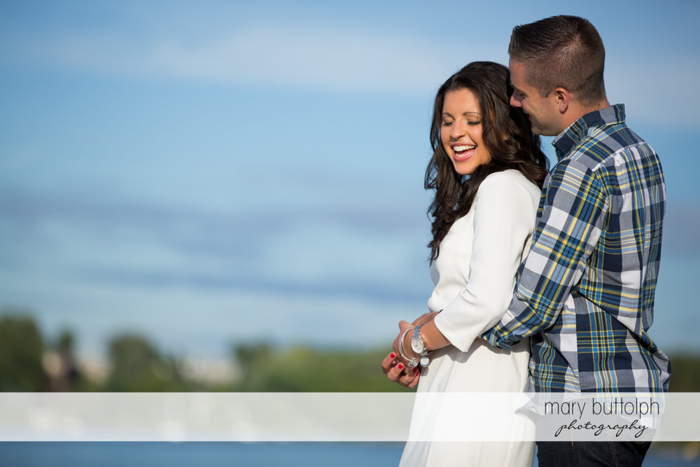 Couple enjoy each other's company near the lake at Skaneateles Country Club Engagement