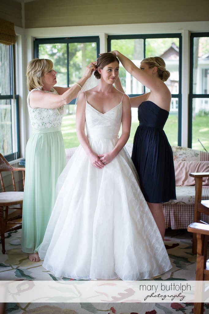 Bride's hair is fixed by friends at the Hamilton Inn Wedding