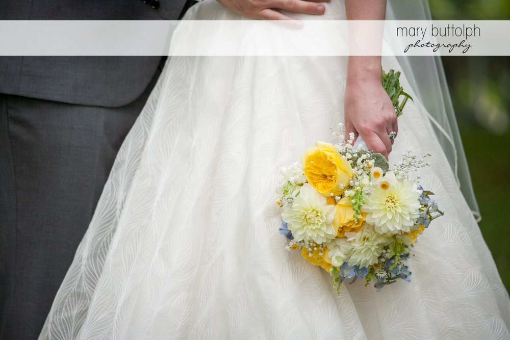 Medium shot of the bride holding a bouquet at the Hamilton Inn Wedding