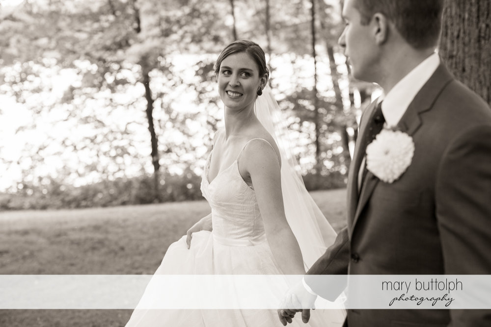 Couple stroll in the woods at the Hamilton Inn Wedding