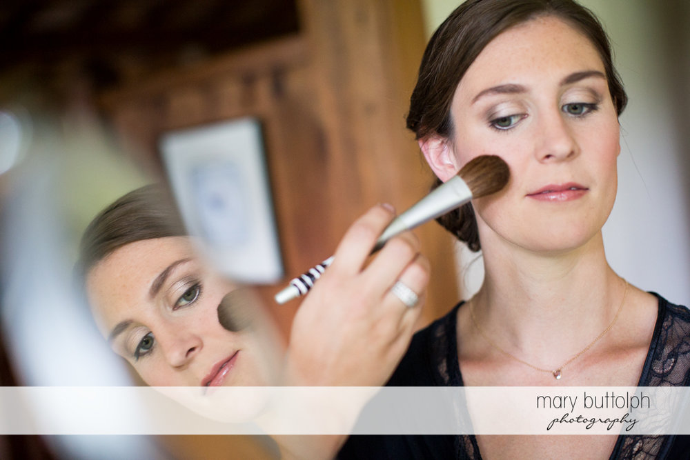 Bride gets a touch up at the Hamilton Inn Wedding