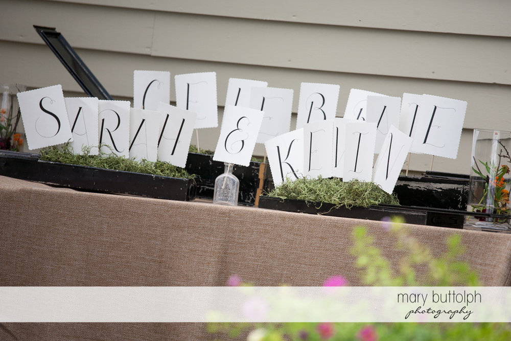 Planters with the couple's names at the Hamilton Inn Wedding