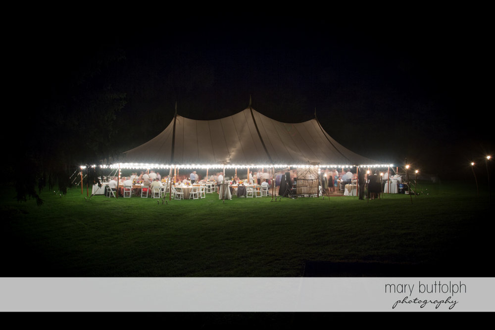 The lighted wedding tent filled with guests at the Hamilton Inn Wedding