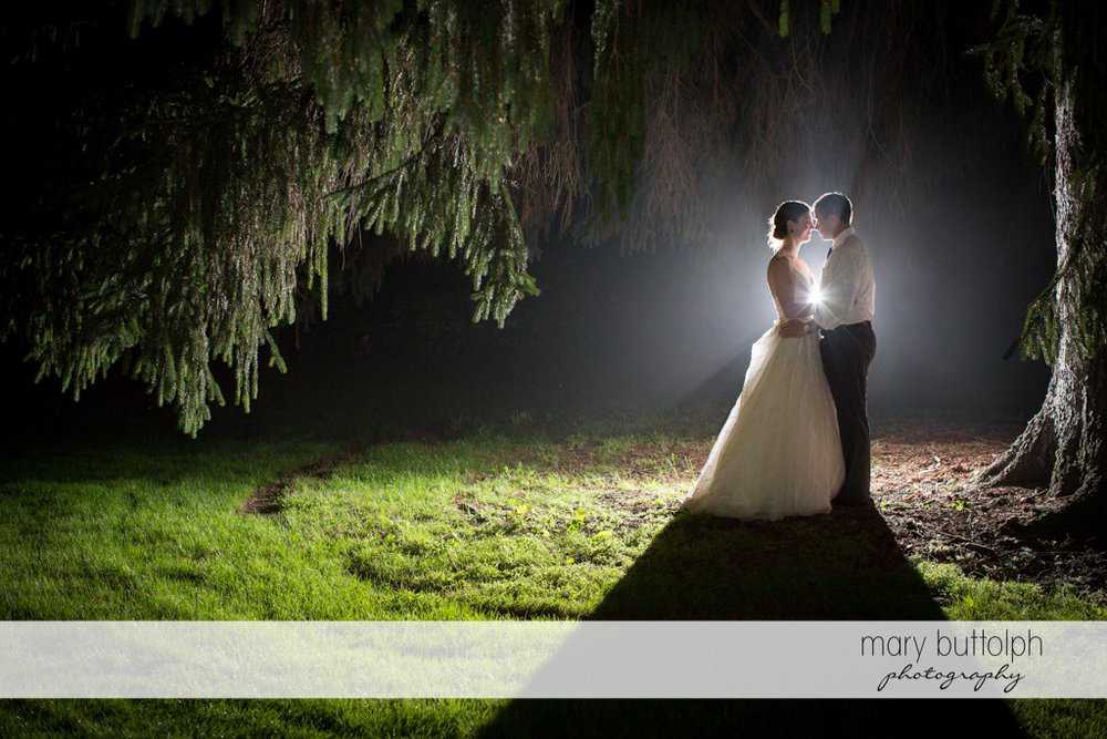Couple rub noses in the garden at the Hamilton Inn Wedding