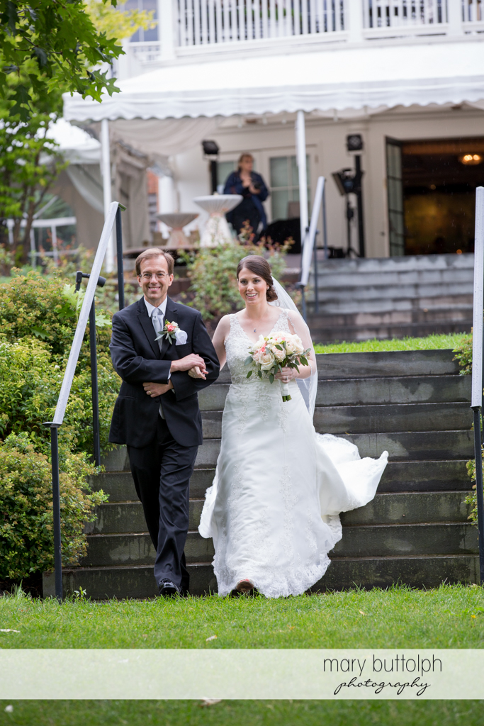 Bride and her father off to the wedding tent at the Inns of Aurora Wedding