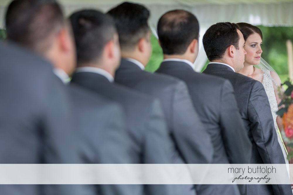 Groomsmen line up in front of the bride at the Inns of Aurora Wedding