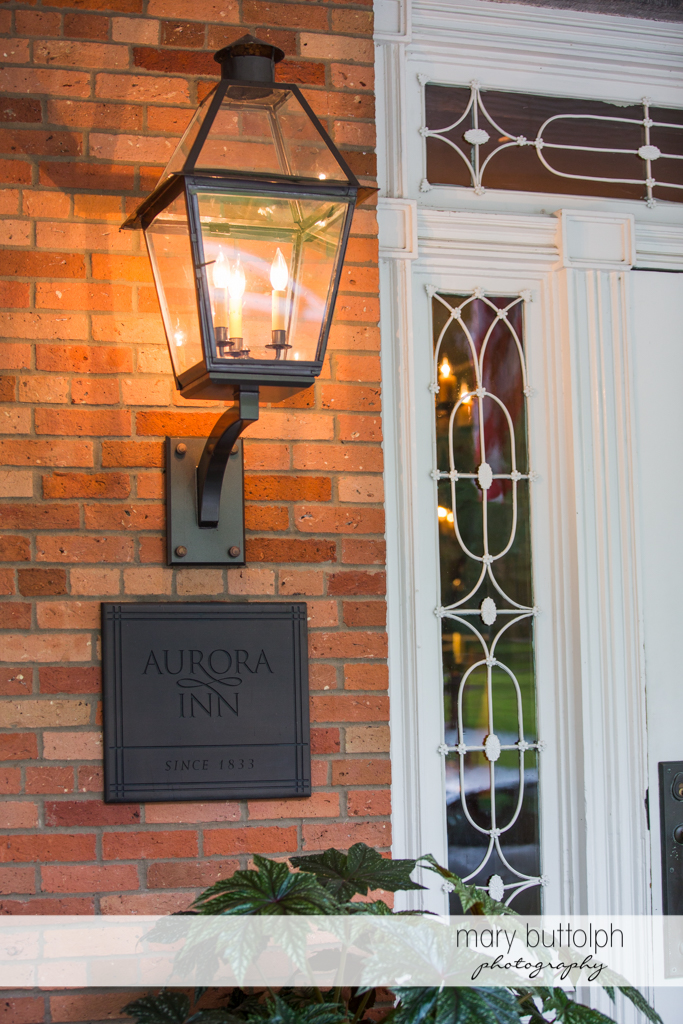 The wedding venue's sign below the electric lantern at the Inns of Aurora Wedding