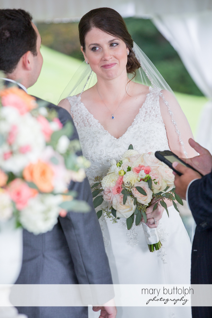 Happy bride faces the groom at the Inns of Aurora Wedding