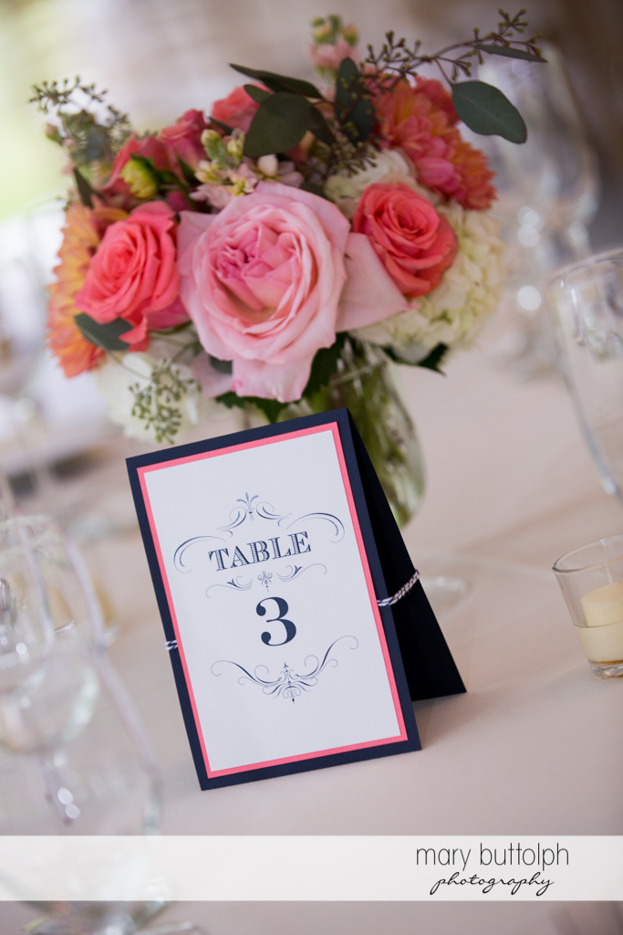 Close up shot of the numbered tables with flowers at the Inns of Aurora Wedding