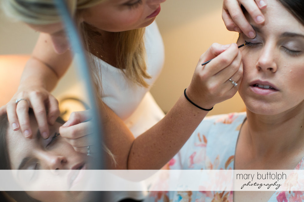 Bride gets a makeover from a friend at the Inns of Aurora Wedding