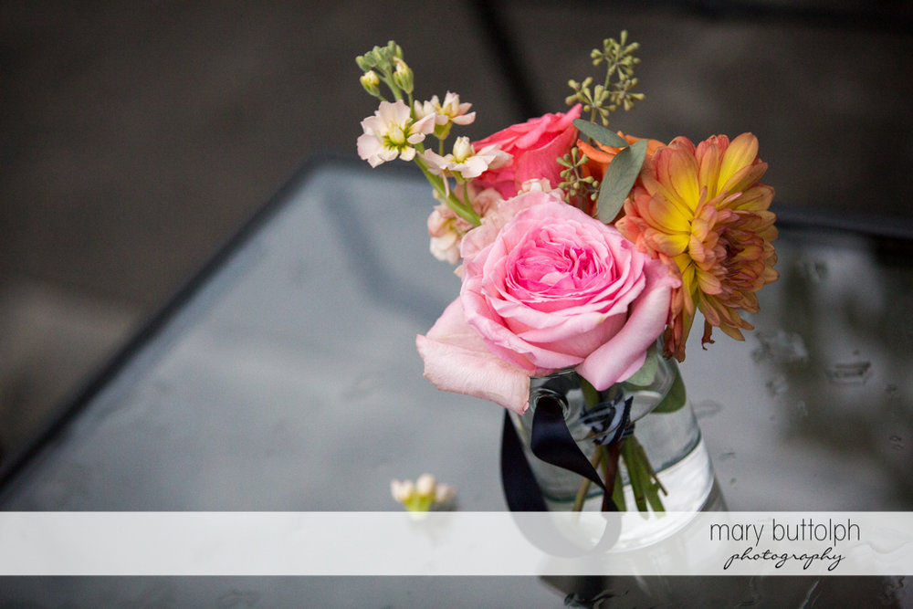 Flowers in a glass at the Inns of Aurora Wedding