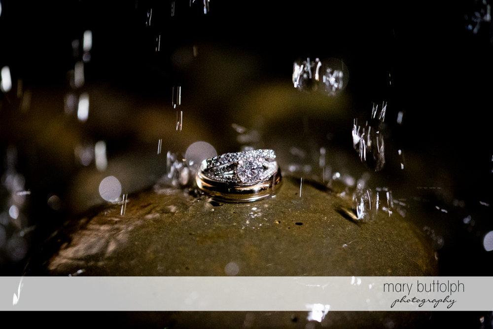 Rain falls on the couple's wedding rings at the Inns of Aurora Wedding