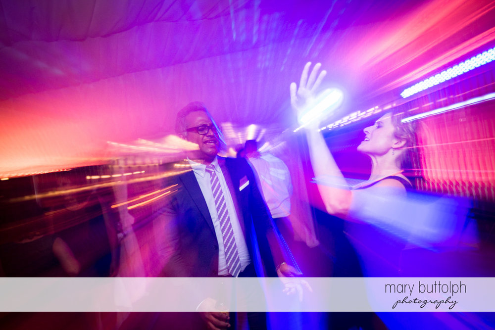 Guests light up the dance floor at the Inns of Aurora Wedding