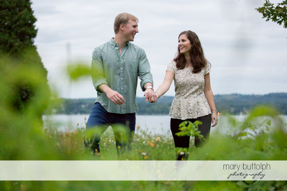 Couple stroll in the garden near the lake at Hobbit Hollow House Engagement
