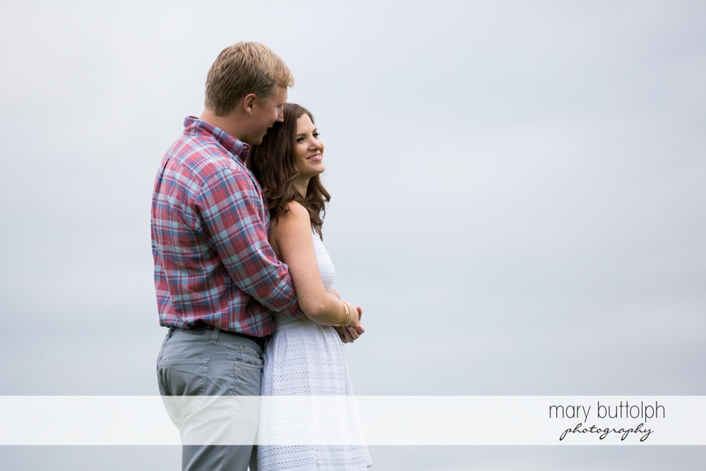 Couple pose for the camera at Hobbit Hollow House Engagement