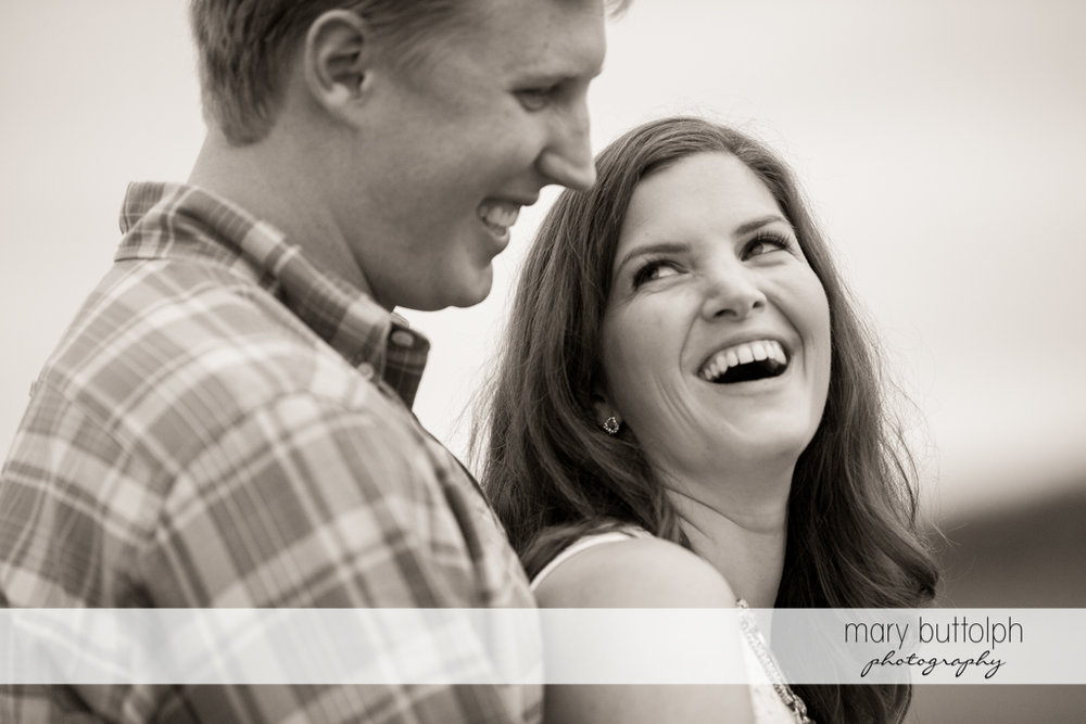 Couple share a happy moment at Hobbit Hollow House Engagement