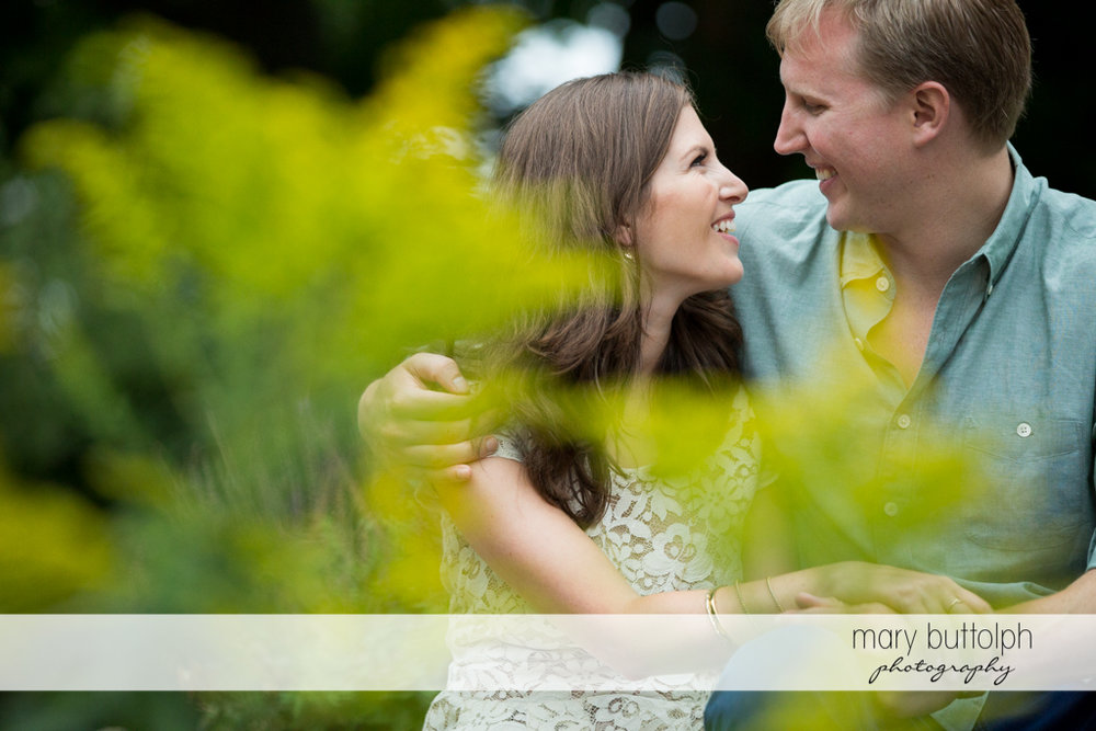 Couple take time off in the garden at Hobbit Hollow House Engagement