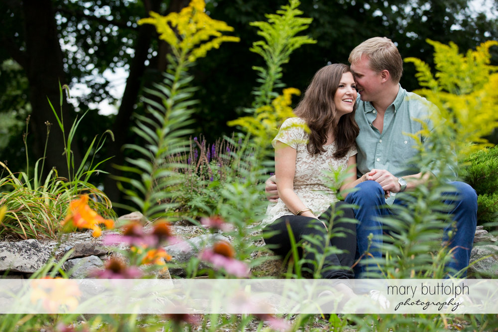 Couple relax in the garden at Hobbit Hollow House Engagement