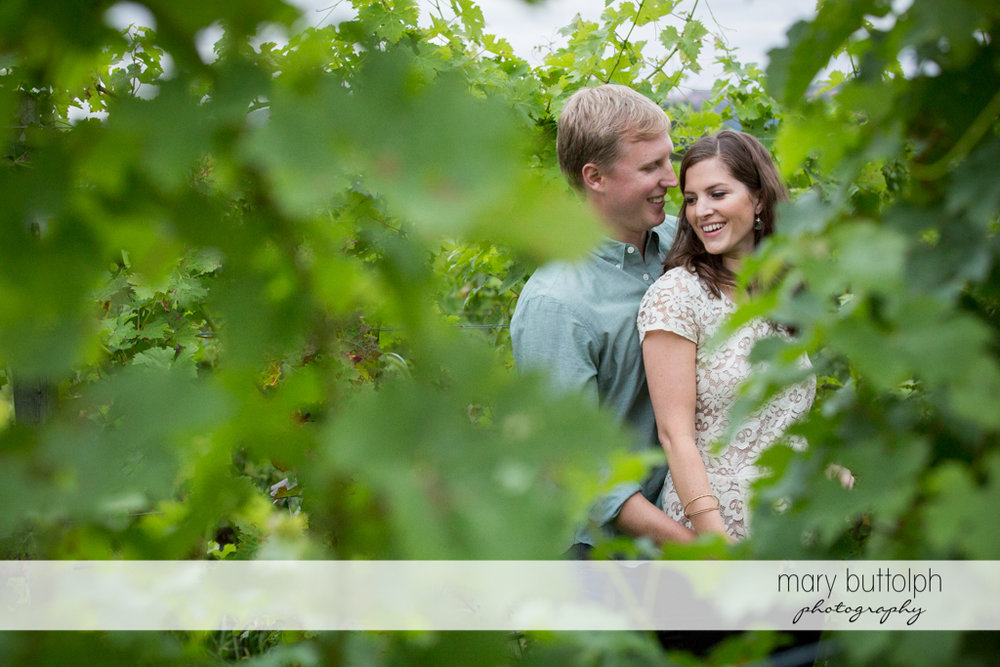 Couple pose in the garden at Hobbit Hollow House Engagement