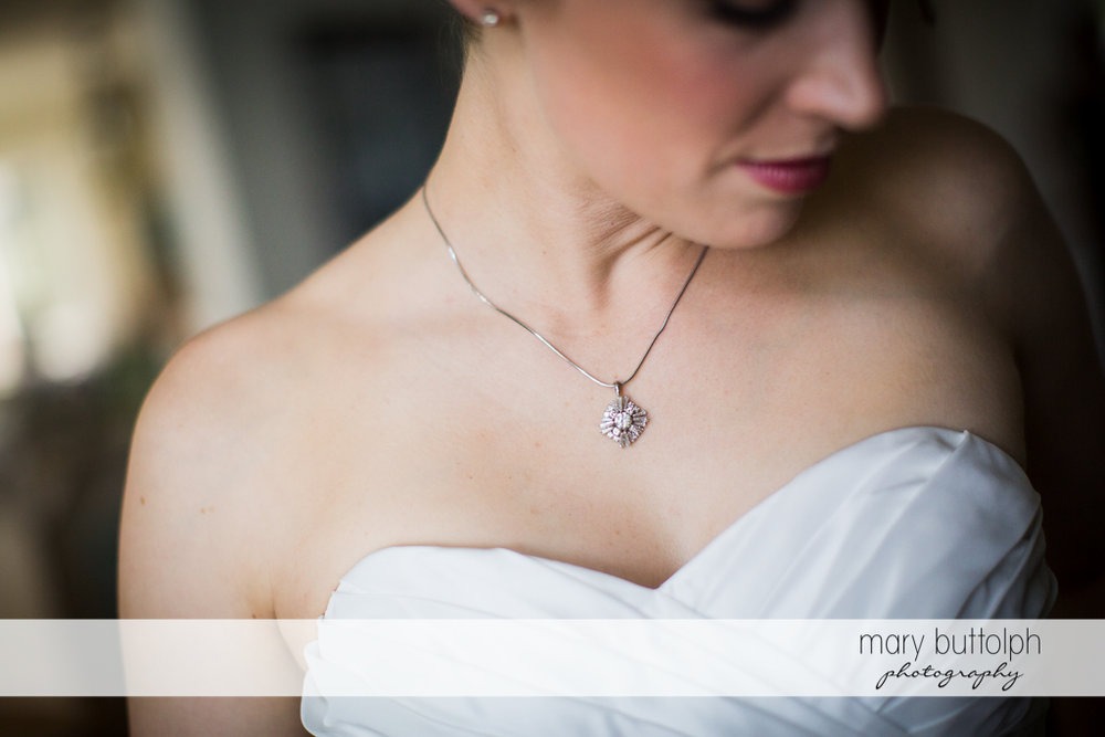 Bride's necklace is clearly visible in this shot at Anyela's Vineyards Wedding
