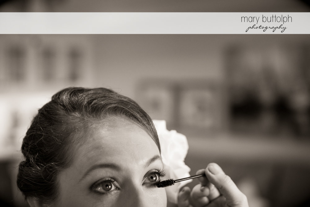 Mascara is applied to the bride's eyelashes at Anyela's Vineyards Wedding