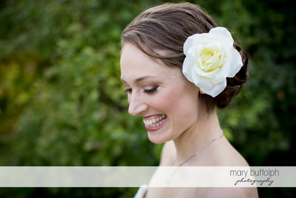 Close up shot of the happy bride in the garden at Anyela's Vineyards Wedding
