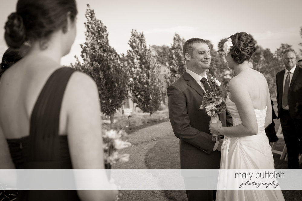 Couple face each other as guests look on at Anyela's Vineyards Wedding