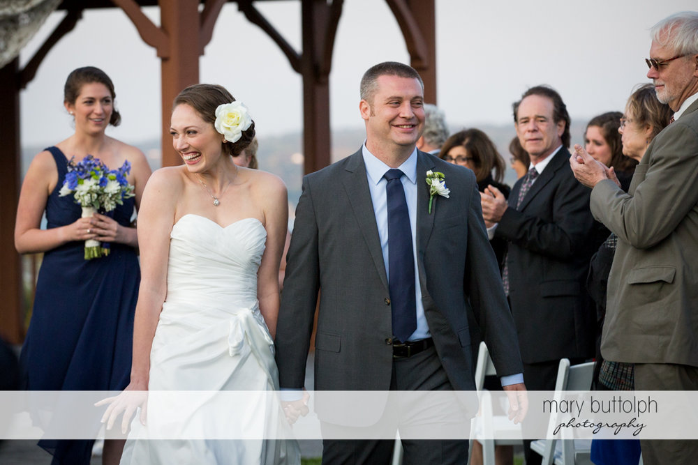 Couple leave after the wedding as guests look on at Anyela's Vineyards Wedding-