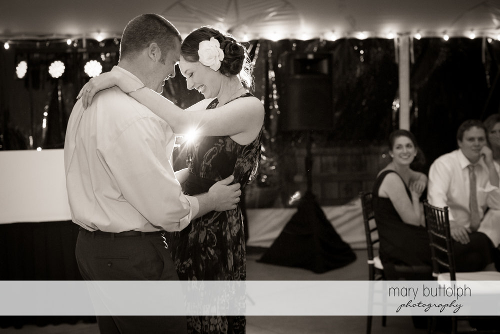 Couple dance under the wedding tent at Anyela's Vineyards Wedding