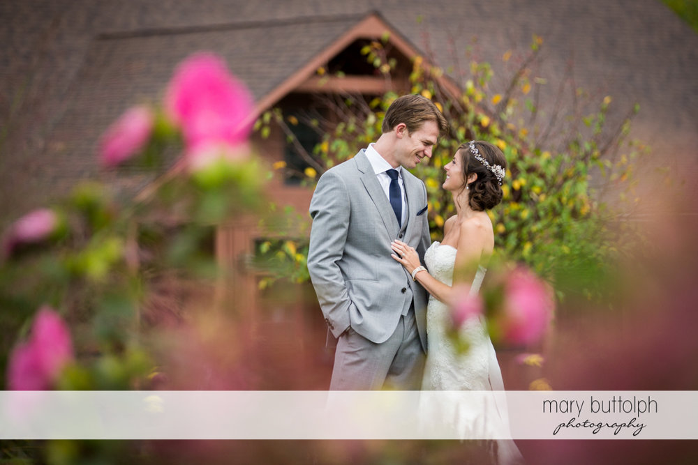Couple pose in front of an old house at Anyela's Vineyards Wedding