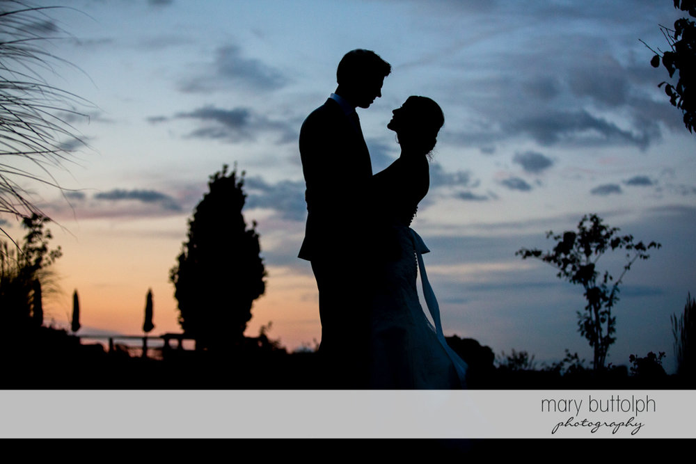Couple catch the last rays of the sun in the garden at Anyela's Vineyards Wedding