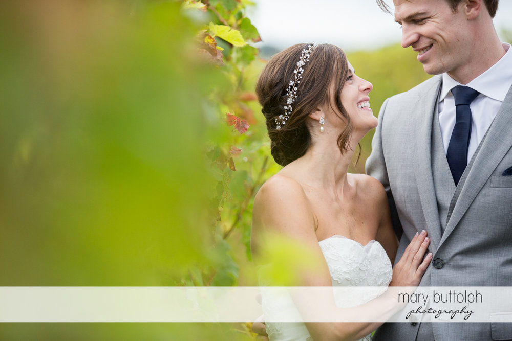 Couple look at each other at Anyela's Vineyards Wedding