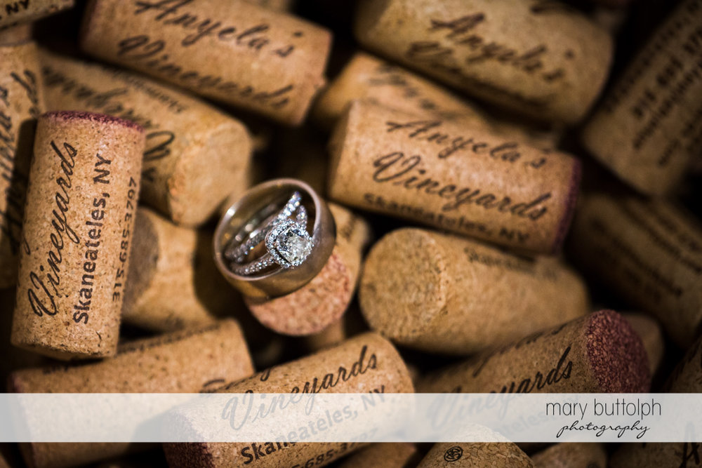 Couple's rings on top of corks at Anyela's Vineyards Wedding