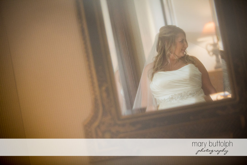 Bride's reflection in the mirror at the Inns of Aurora Wedding