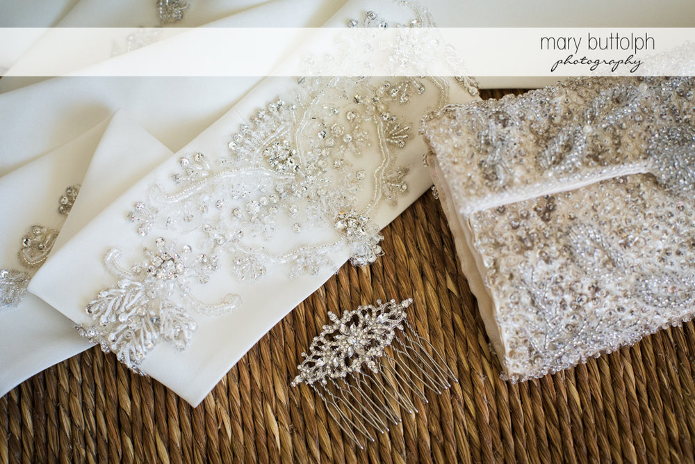 Close up of the bride's wedding gown and her hairpin at the Inns of Aurora Wedding