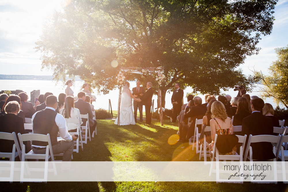 Couple's garden wedding with guests at the Inns of Aurora Wedding