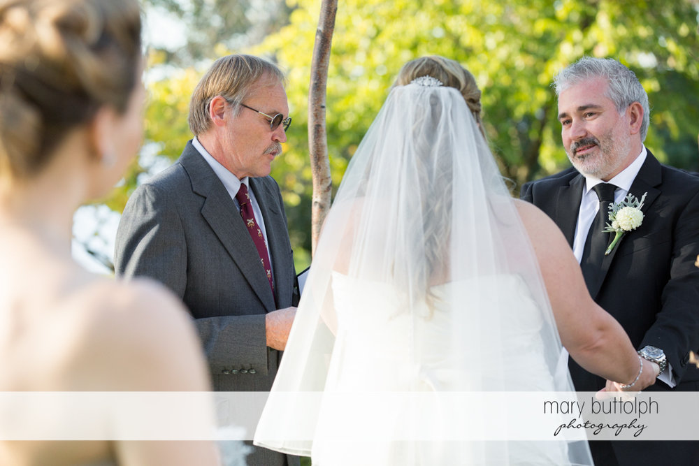 Couple in front of the wedding officiant at the Inns of Aurora Wedding