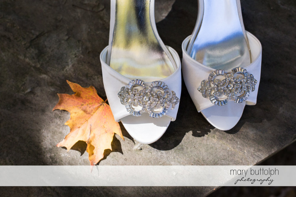 Close up shot of the bride's wedding shoes at the Inns of Aurora Wedding