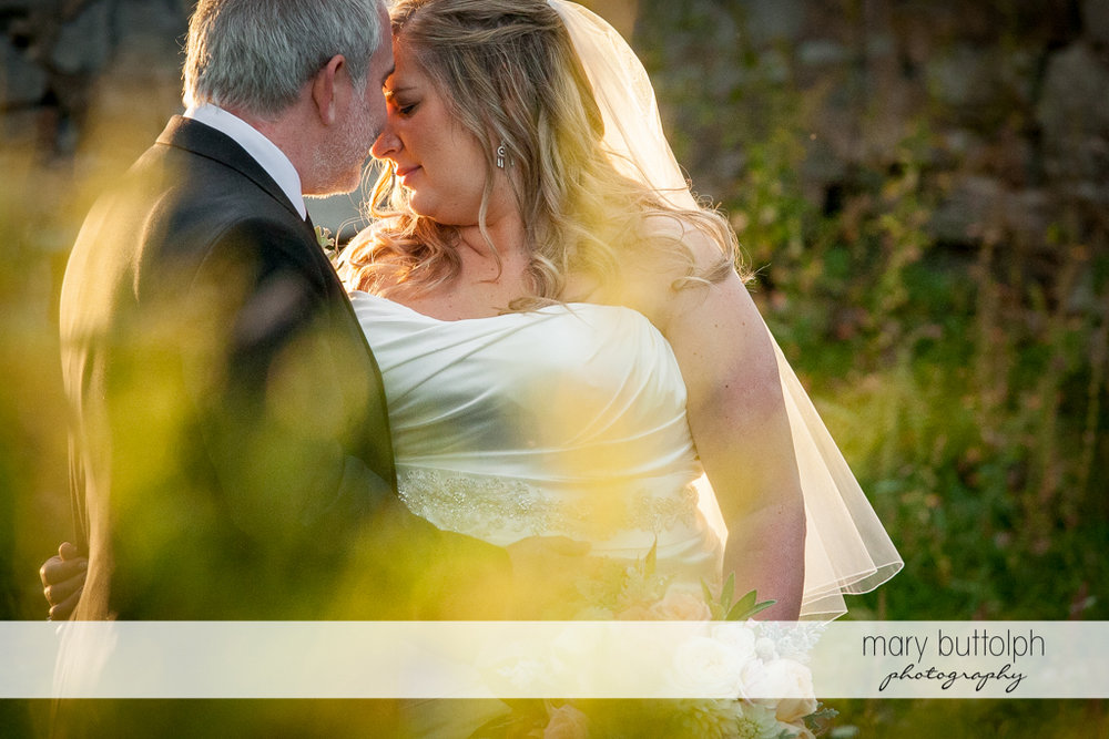 Couple rub noses in the garden at the Inns of Aurora Wedding