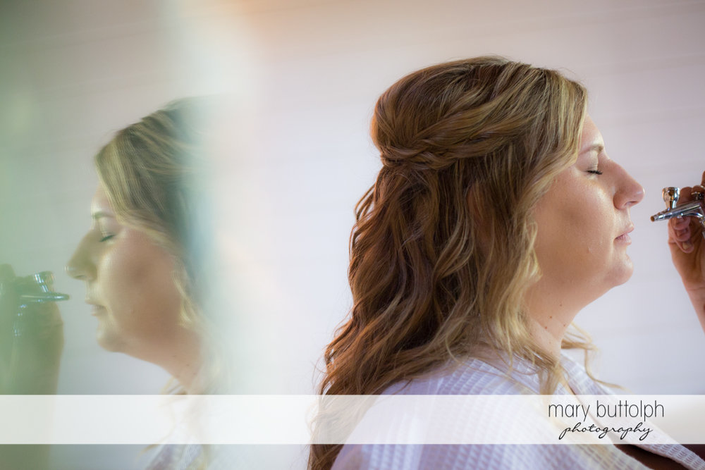 Bride gets a makeover via airbrush makeup at the Inns of Aurora Wedding