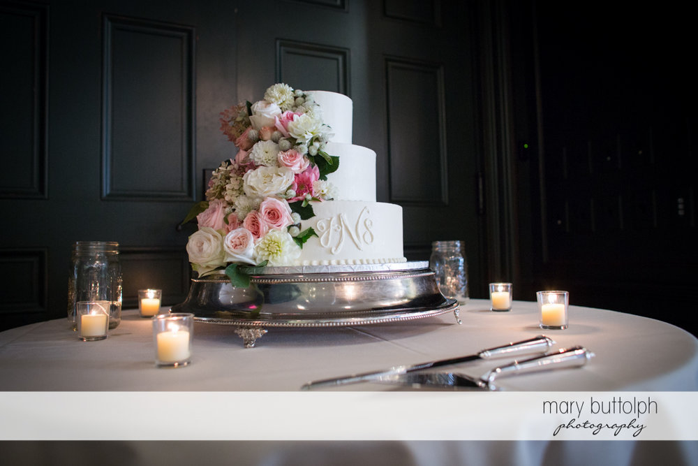Couple's cake waits for guests at the Inns of Aurora Wedding