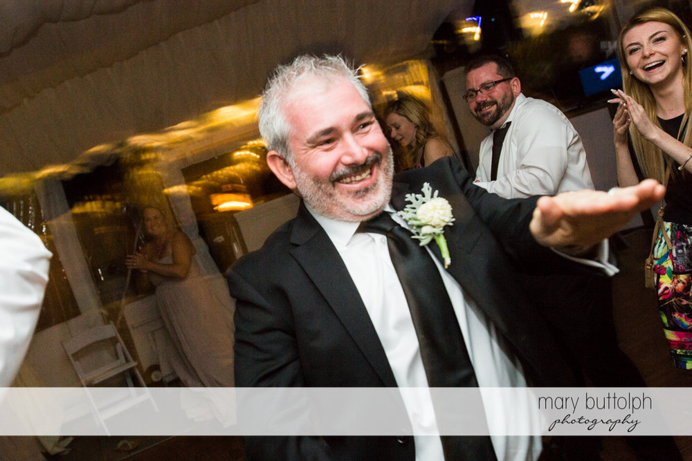 Groom shows his dance moves at the Inns of Aurora Wedding