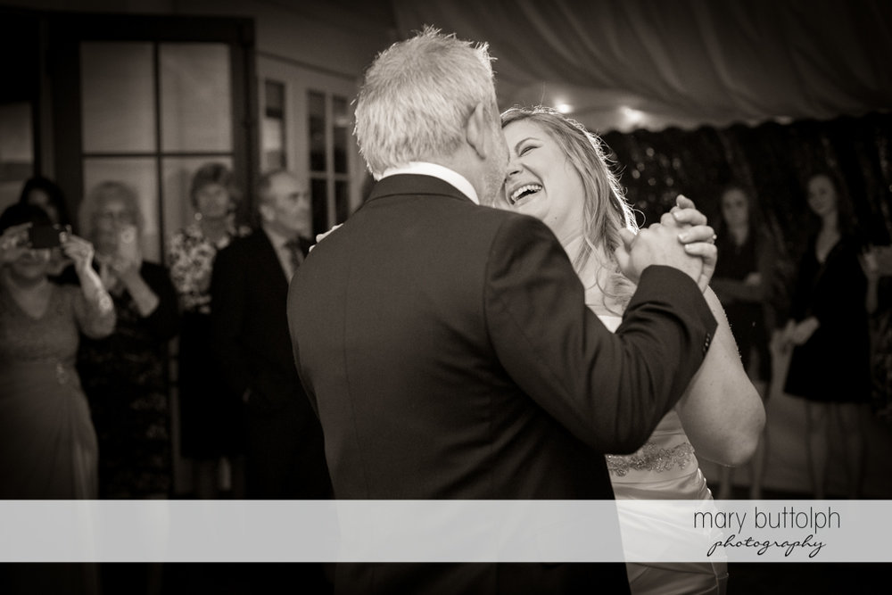 Bride laughs as she dances with the groom at the Inns of Aurora Wedding
