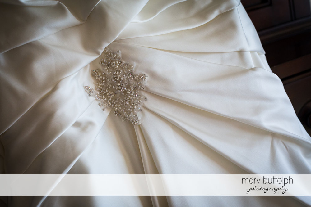 Detail of bride's wedding dress at the Inns of Aurora Wedding