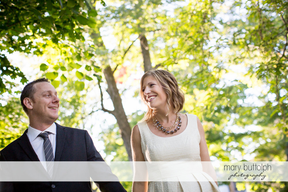 Couple in a happy mood in the garden at the Inns of Aurora Engagement