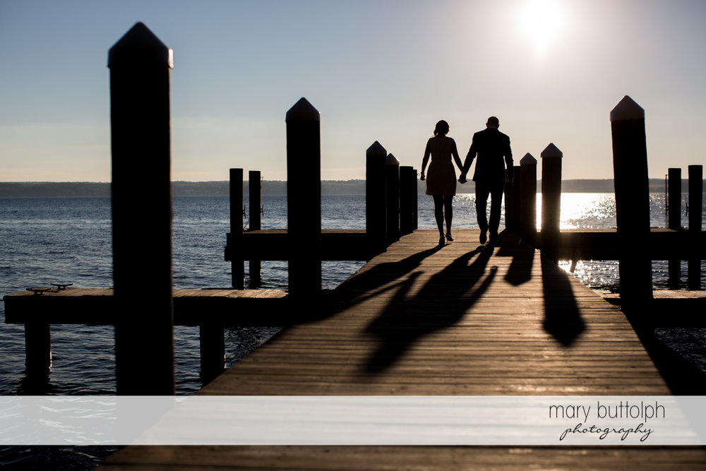 Couple catch the sunset by the lake at the Inns of Aurora Engagement