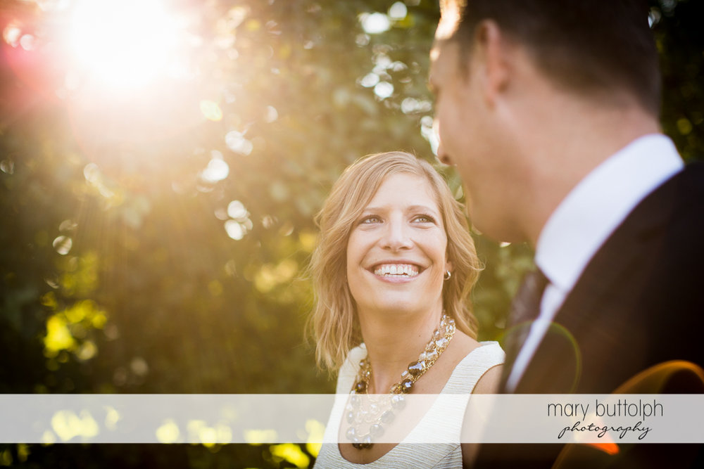 Couple face each other in the garden at the Inns of Aurora Engagement