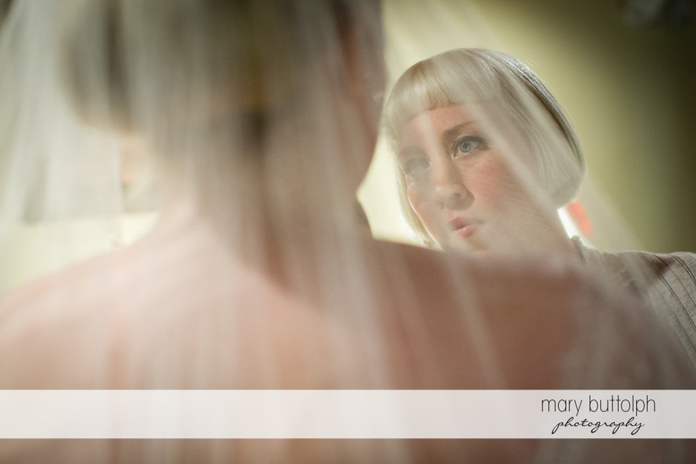 Bride faces one of the bridesmaids at Skaneateles Country Club Wedding