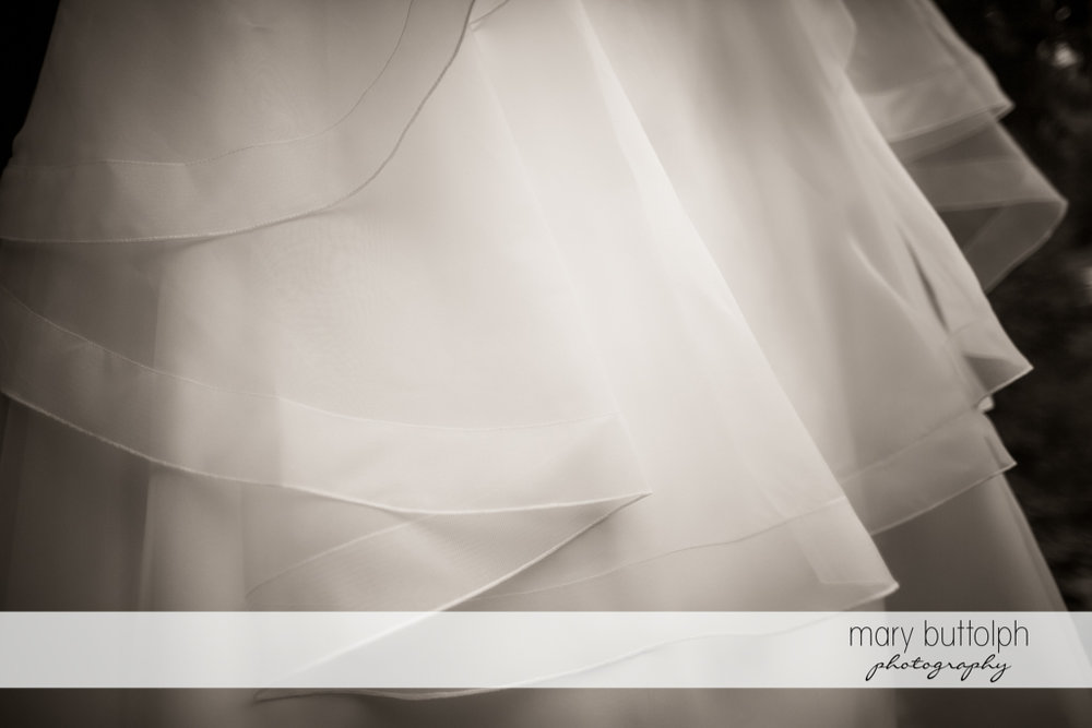 Close up shot of the bride's wedding gown at Skaneateles Country Club Wedding