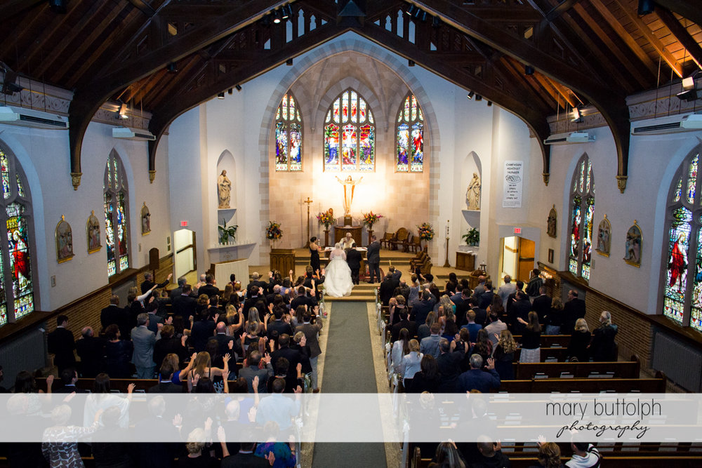 Long shot of the couple in front of the altar at Skaneateles Country Club Wedding